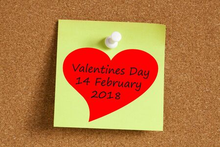 Valentines Day 14 February 2018 written on remember note pinned on a cork board.Business concept.
