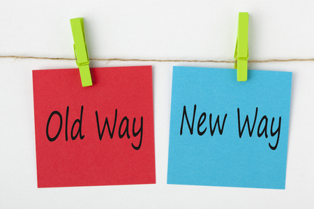 Old Way and New Way note paper with wooden pinch on white background. Business Concept. 스톡 콘텐츠