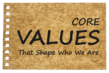 CORE VALUES written on brown of recycled paper on white background. That Shape Who We Are? Business concept.  Stock Photo