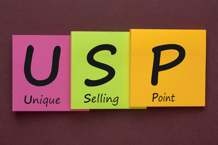 USP Unique Selling Point written on color notes. Acronym business concept.
