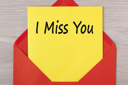 I Miss You written on letter in red envelope.