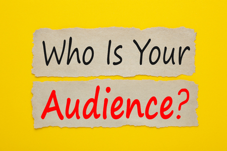 Who Is Your Audience? written on old torn paper on yellow background.  Stok Fotoğraf