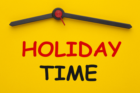 Holiday Time text on yellow clock. Business Concept. Stockfoto - 102322571