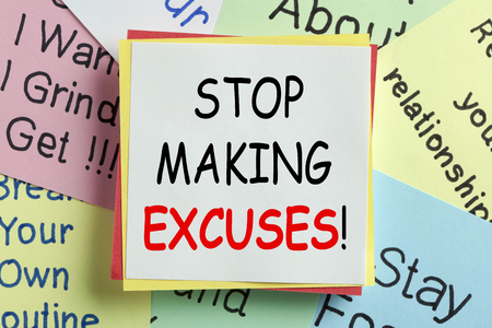STOP MAKING EXCUSES written on a note paper. Business Concept.