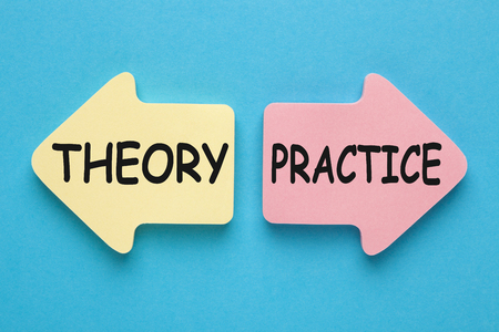 THEORY vs PRACTICE written on paper arrows on blue background. Business concept.