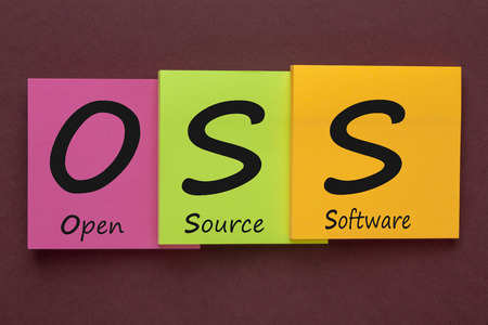 OPEN SOURCE SOFTWARE (OSS) written on color notes. Acronym business concept.