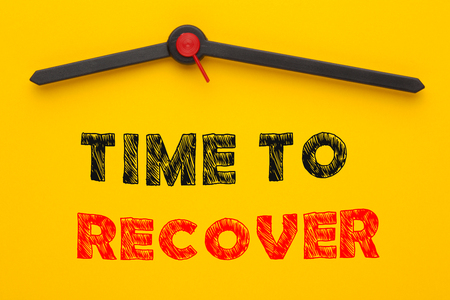 Time to Recover written on yellow clock. Motivational quotes. Stock Photo