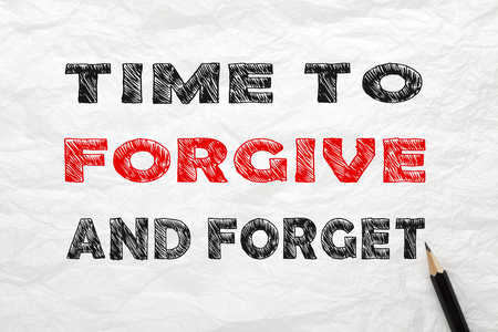 Time to Forgive and Forget written with pencil on wrinkled lined paper. Concept to change your life.