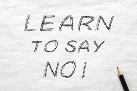 Learning to Say No written with pencil on wrinkled lined paper.