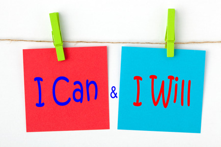I can and I will written on color notes with wooden pinch. Motivational concept.