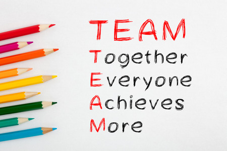Team acronym and colored pencil on white background with word Together, Everyone, Achieves and More. 版權商用圖片