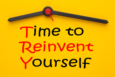 Time to Reinvent Yourself written on yellow clock. TRY acronym.