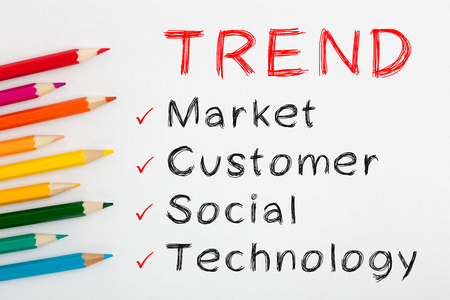 Trend and colored pencil on white background with word Market, Customer, Social and Technology.