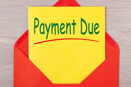 Payment Due written on letter in red envelope. Notice letter.