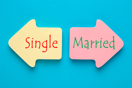 Single versus Married written on paper arrows. Change in your relationship.