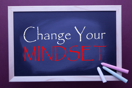 Change Your Mindset written on blackboard by color chalks. Business concept.