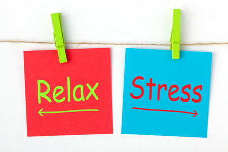 Stress versus Relax words written on color notes with wooden pinch. Choice conceptual.