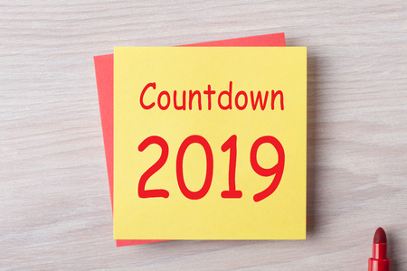 Countdown 2019 written on note with marker pen. Business concept.