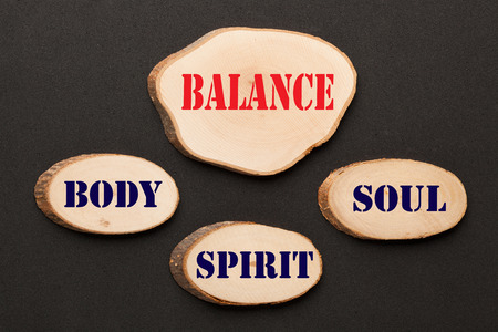 Body Spirit Soul Balance written on wooden ellipses. Business concept. Imagens