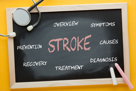 Stroke diagram on blackboard by color chalks and stethoscope. Medical concept. Stock Photo