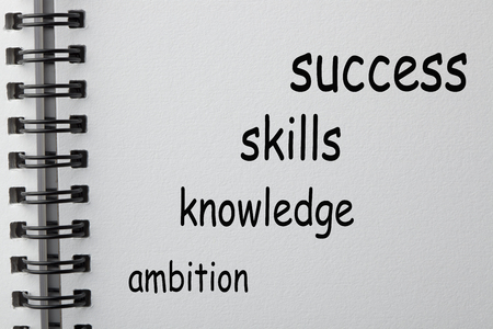 Success , knowledge, skills and ambition words in the shape of a staircase on notebook. Business concept. Stok Fotoğraf