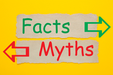 Facts and Myths written on old paper on yellow background. Change Your Mind. Business Concept.