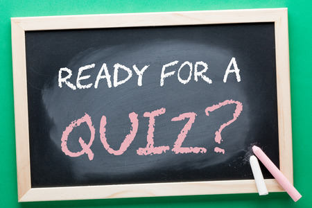 READY FOR A QUIZ question written on blackboard and color chalks. Business concept.