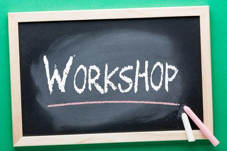 Workshop written on blackboard and color chalks. Education concept.