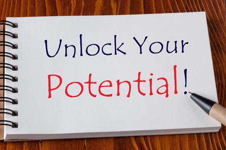 Unlock Your Potential written on notebook with pen aside on wooden desk. Business Concept. Reklamní fotografie