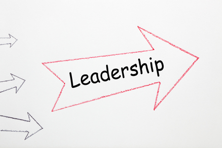 Leadership written on red arrow direction sign with black arrows on white background. Business Concept Reklamní fotografie