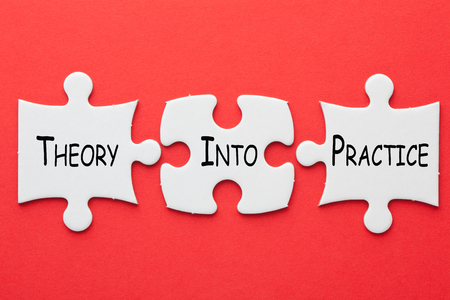 Theory Into Practice text in 3 pieces paper puzzle on red background. Acronym business concept.