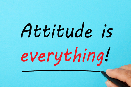 Handwriting Attitude is everything text on a blue background. Business concept.