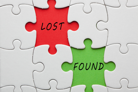 Lost and Found words on colorful pieces paper puzzle. Business concept