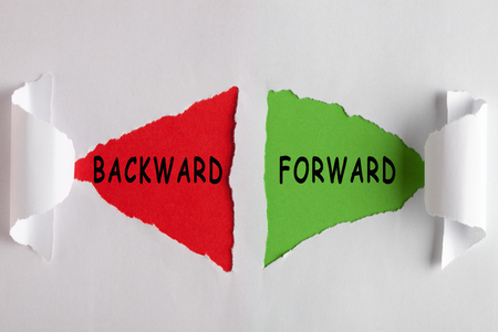 Backward and Forward word written in colorful stickers pinned on cork board. Business concept 免版税图像