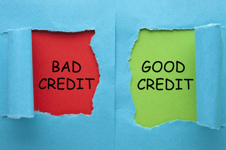 Good Credit vs Bad Credit words on blue torn paper in red and green background. Business concept Stok Fotoğraf