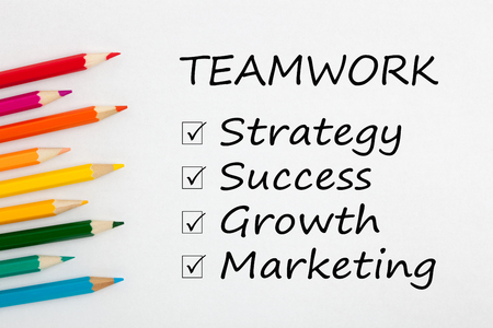 Group of color pencil on white background with words Teamwork, Strategy, Success, Growth and Marketing. Stock fotó