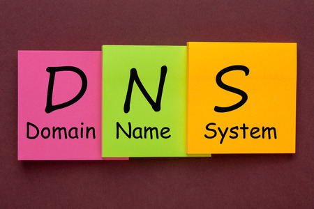 Domain Name System (DNS) acronym on colorful note in the shape of a staircase. Business Concept.