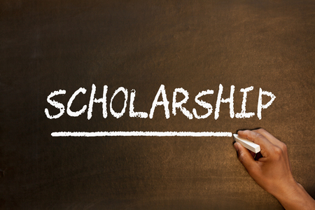 SCHOLARSHIP handwriting with chalk on blackboard. Business concept.