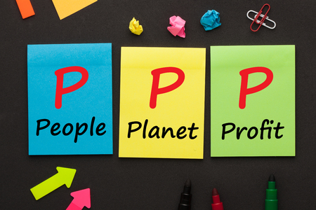 People Planet Profit (PPP) text on color notes and office supplies on black background.