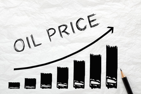 Oil Price with directional arrow written on wrinkled lined paper. Diagram in the shape of a staircase, financial concept.