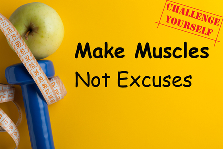 Make Muscles, Not Excuses! Challenge Yourself. Concept sport, diet, fitness, healthy eating.