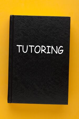 Tutoring text in a book cover on a yellow background.