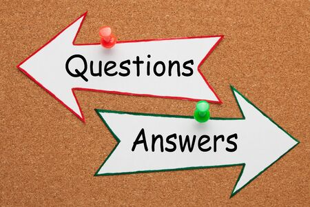 Questions and Answers words on paper arrow pinned on cork board. Business concept. Reklamní fotografie