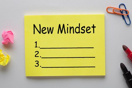 New Mindset blank list on note with marker pen and various stationery. Business concept.