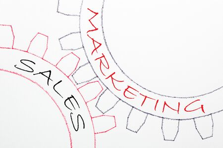 Sales and Marketing text on mechanism of gears. Communication concept.
