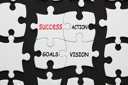 The words Success, Action, Goal and Vision on 4 piece puzzle. Business concept. 写真素材