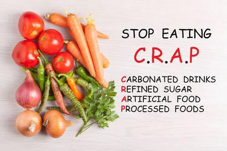Stop Eating C.R.A.P text and group vegetables. Diet, healthy life style concept.