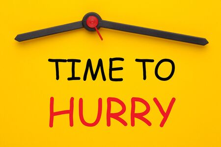 The words Time to Hurry on a clock on yellow dial. Countdown to a deadline