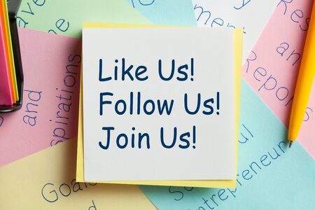 Like Us, Follow Us and Join Us written on a note paper. Concept of social media marketing and management. 写真素材