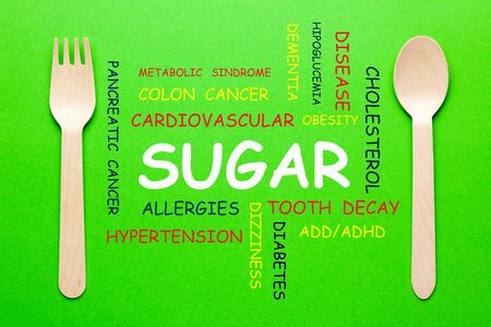 Word cloud concept of Sugar with spoon and fork on green background.